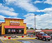Marcus & Millichap Arranges Sale Tri-Peak Plaza Retail Property