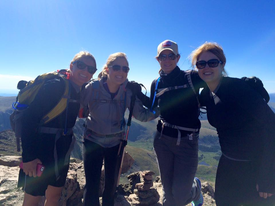 Amy, second from the left, enjoys climbing 14'ers with her friends when not in the office.