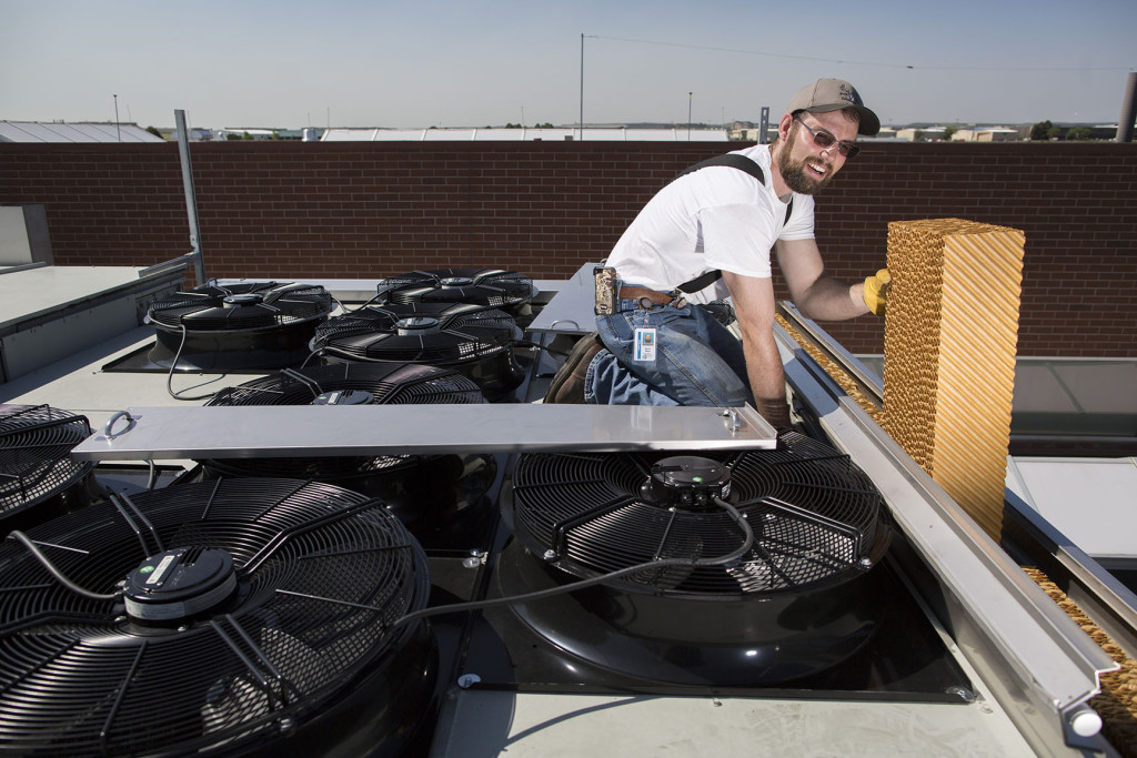 Workers install evaporative coolers on the Arapahoe County Sheriffs Office in Centennial, Colo. Thursday, June 16, 2015. (Photo by Bear Gutierrez)