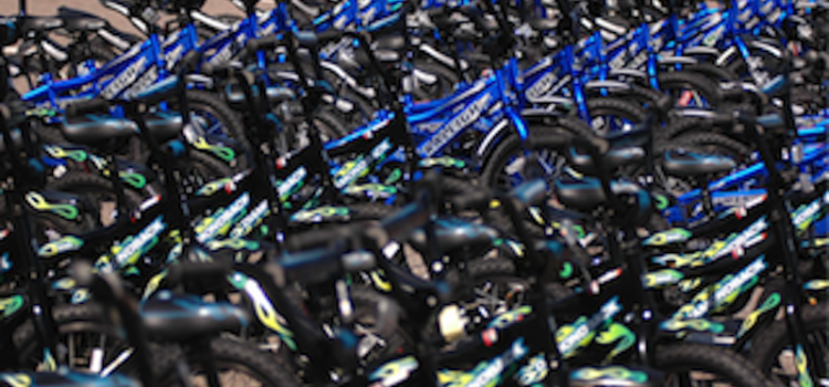 DMCAR Partners with Wish for Wheels to Build and Deliver Bikes for Area Youth
