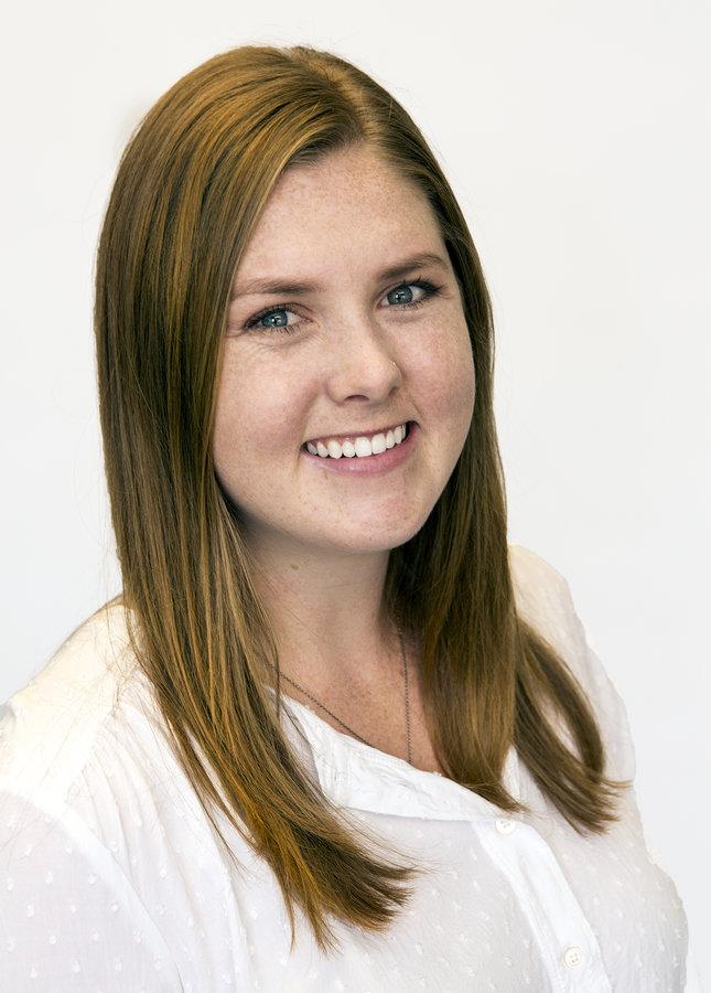 Headshots of Emily Conroy at CRESA in Denver, Colorado.