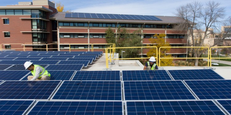 Contractors with Namaste Solar install an array of solar panels on the roof of Colorado State University's Braiden Hall, courtesy of CSU.