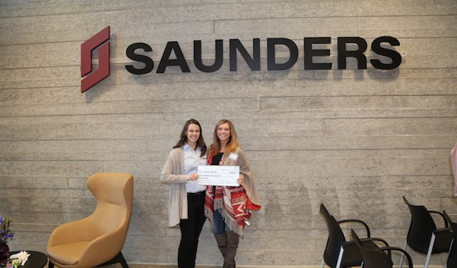Saunders awarded a $500 scholarship to Mattie Carter, a construction management major at Colorado State University (CSU).